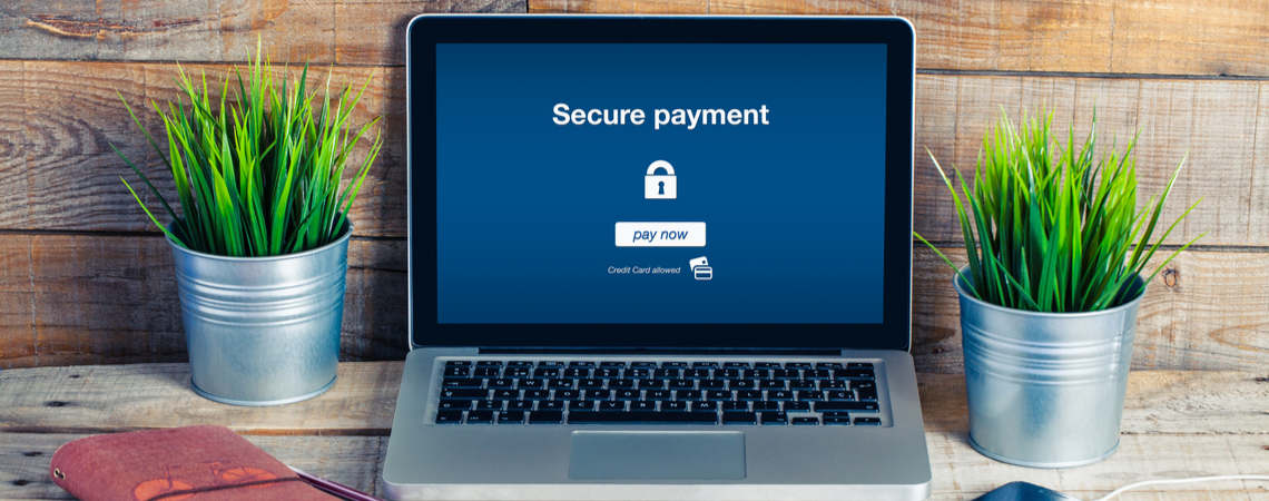 Laptop mit Hinweis auf sichere Zahlung