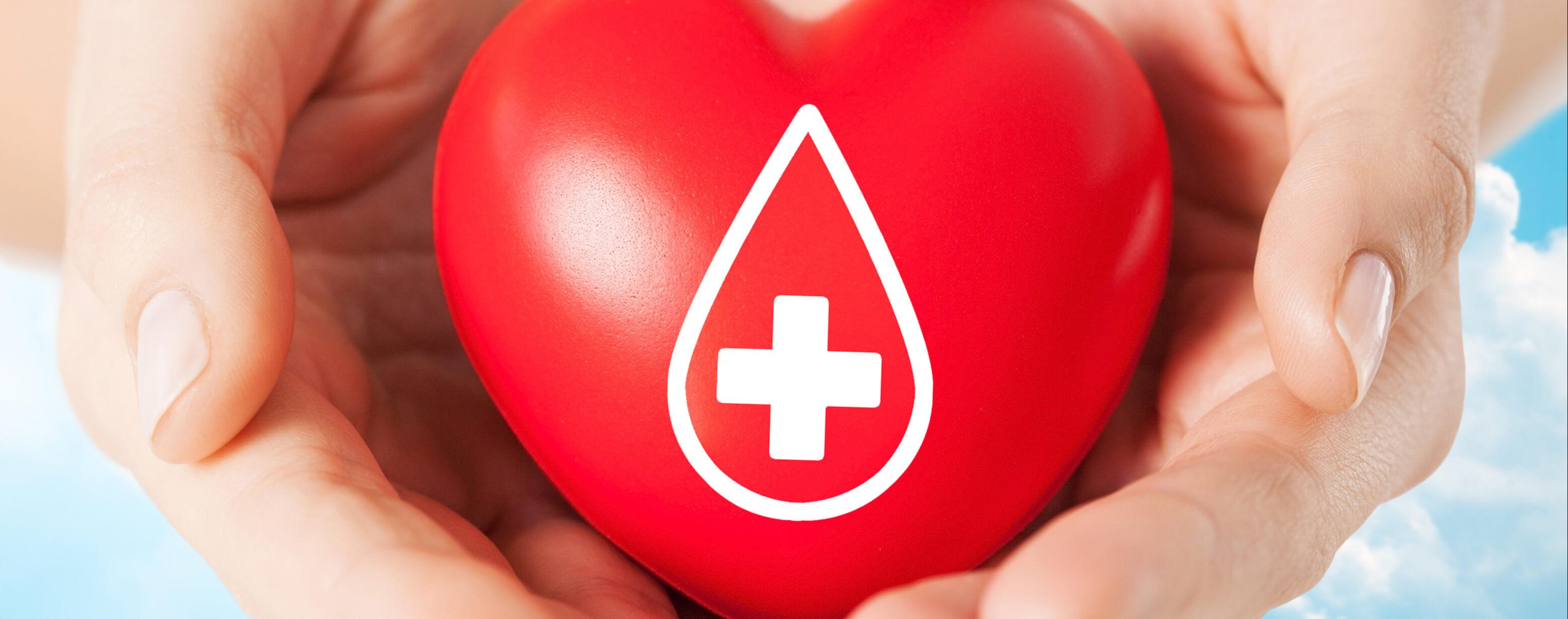 rotes Herz mit Kreuz und Tropfen
