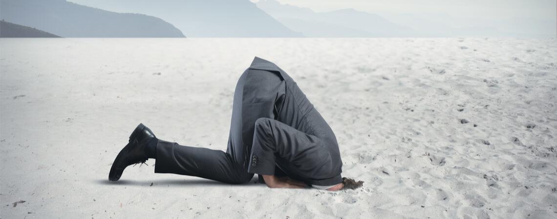 Kopf in den Sand stecken