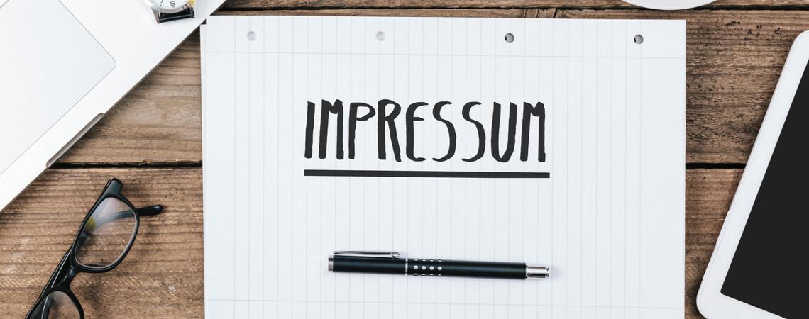 Impressum auf Schreibblock