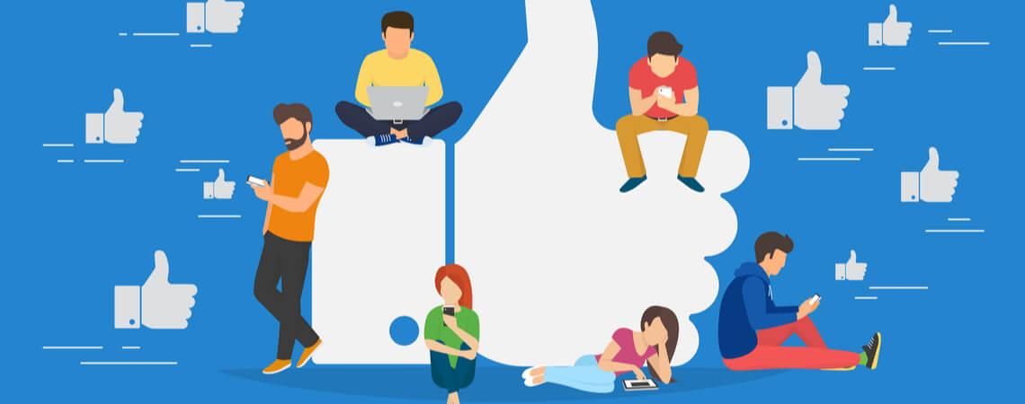 Junge Menschen sitzen auf einem Gefällt-Mir-Daumen