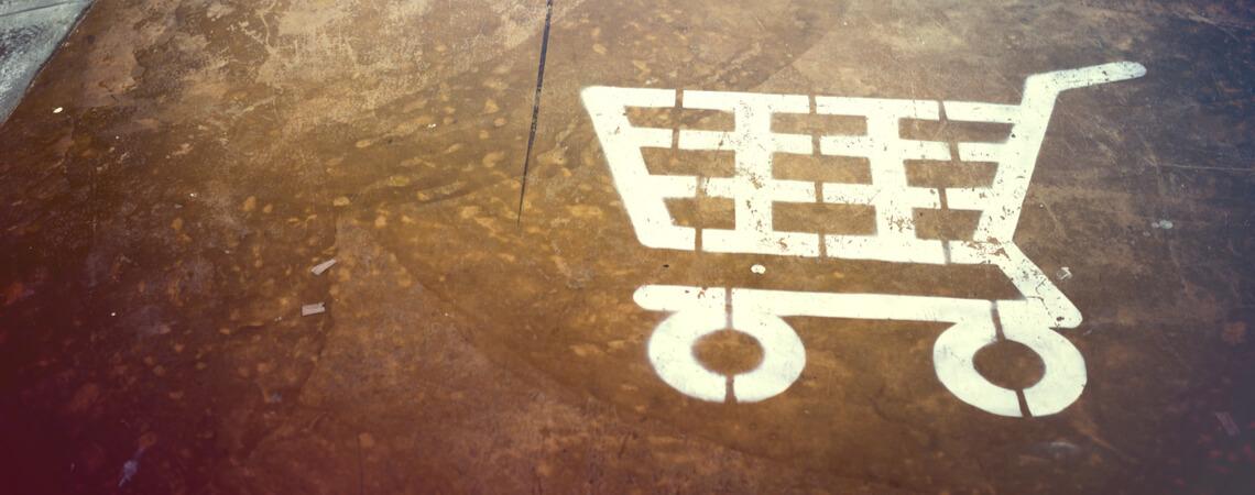 Symbol eines Einkaufswagens auf dem Boden