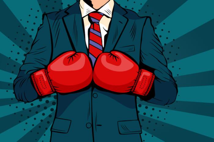 Kampf um die Marke: Business-Mann mit Boxhandschuhen