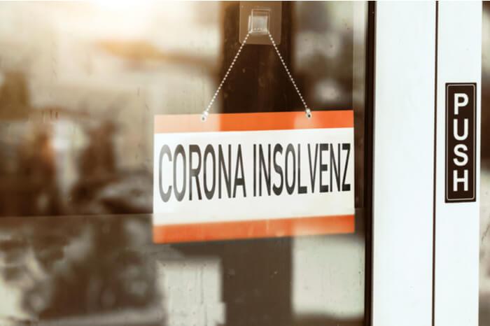 Schild an Tür mit Corona Insolvenz