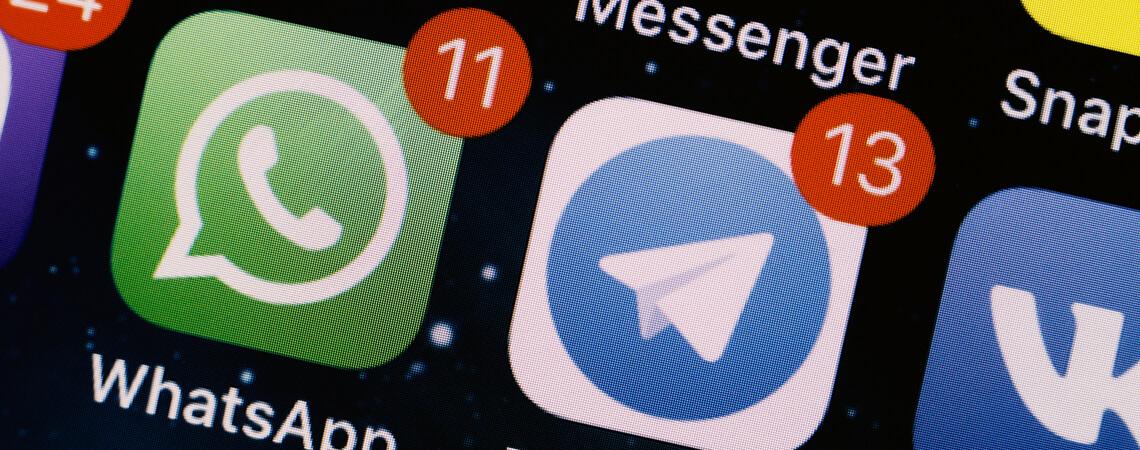App-Symbol von Telegram und WhatsApp