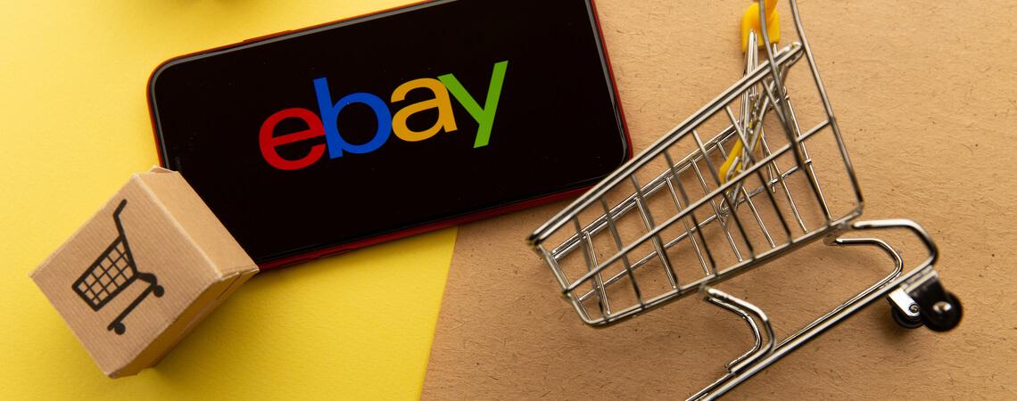 Ebay Symbol mit kleinen Boxen und Einkaufswagen