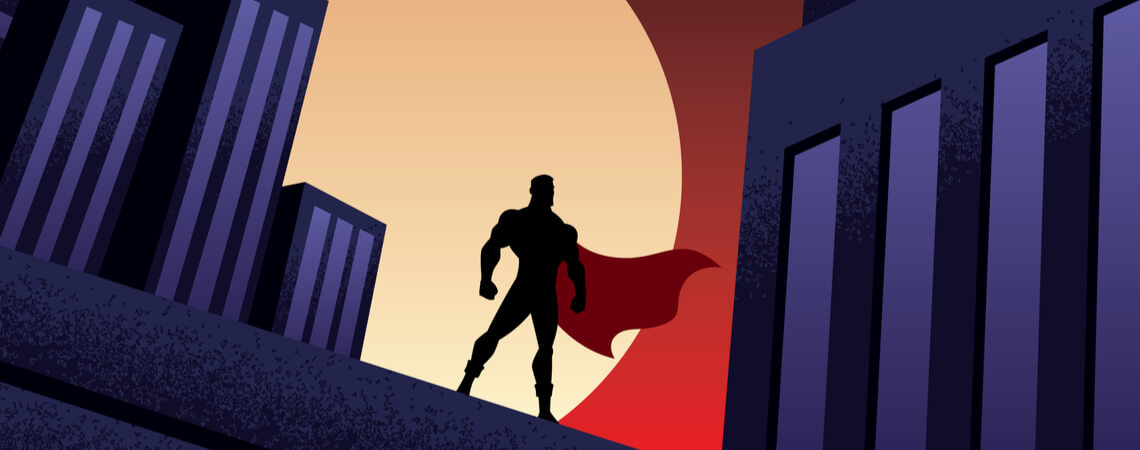 Comic: Superheld mit wehendem Umhang steht auf Hausdach